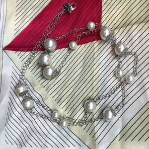 Long silver necklace with faux pearls